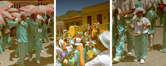 The Kaapse Klopse troupes playing instruments and dancing