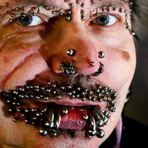 Man with 453 piercings denied entry to Dubai