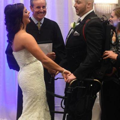 Paralysed groom walks down the aisle