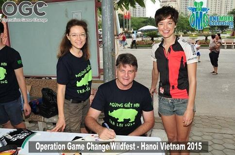Grant Fowlds signing the Rhino Declaration for the Buy No Rhino team — with Vicki from Buy No Rhino, Grant Fowlds and Ness from Buy No Rhino.