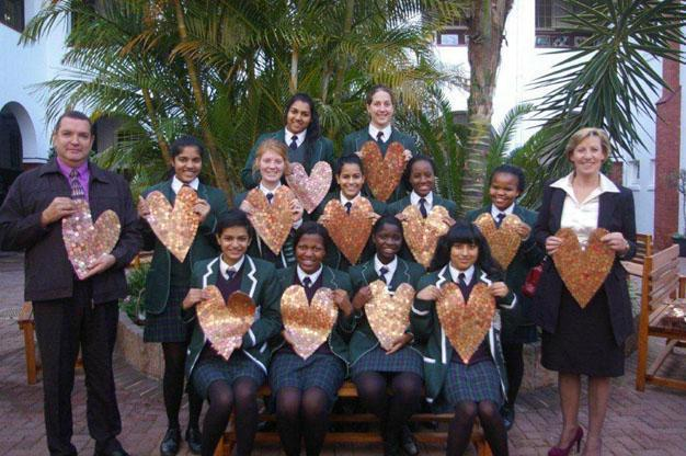 BIG HEARTS: Interact Club co-ordinator Marius Fourie, members of the Interact Club and St Bernard's CEO Rene Wienekus Picture: SUPPLIED