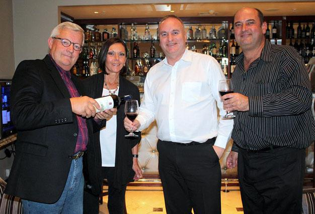 LET'S DRINK TO THAT: Harrison Hope wine estate owners, from left, Ronnie and Janet Vehorn toast the launch of their wines at Hemingways Hotel and Casino, as food and beverages manager James Brown and marketing manager, Neville Austin, celebrate the moment Picture: ETHIENNE ARENDS