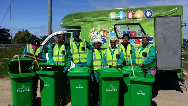 The hard working recycling team from DNF Waste and Environmental Services, cleaning up Settlers Way.  PHOTO:  Saskia Haardt