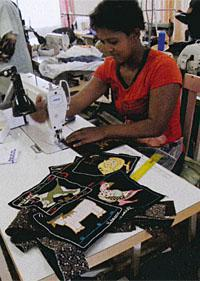 Once washed the embroidered squares are sewed onto traditional shweshwe material
