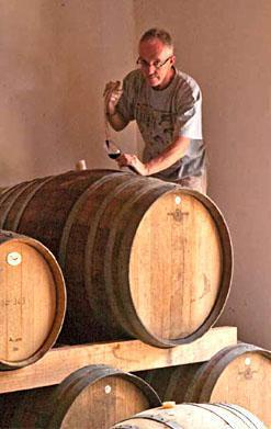 Mike Neebe checking his port with a wine stealer at Axe Hill winery.