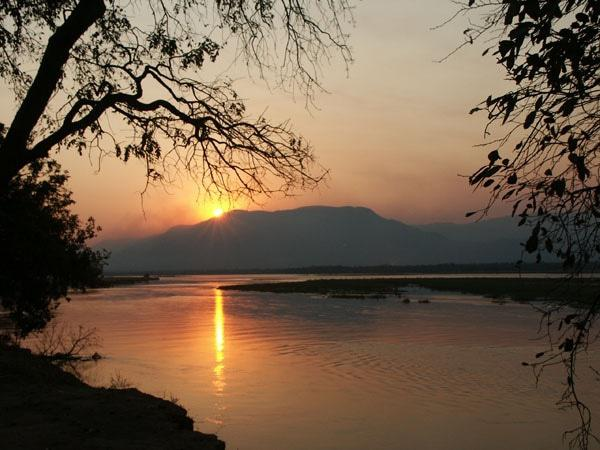 Have a drink in your hand and enjoy the sunset from your campsite at Mana Pools. Photo Graham Theobald