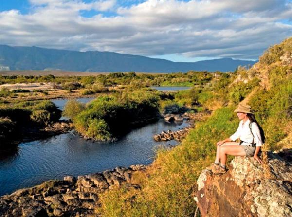 Petra stops to rest and enjoys the views along the Breede River that forms the western border of the park.