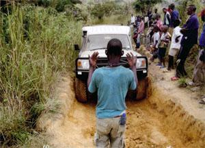 """Our personal traffic officer, in the DRC, every vehicle had it's own """"road guide"""", guiding the vehicle through the newly created road"""