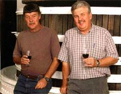Brothers Stroebel (left) and Boets Nel believe in the traditional method of making Port.