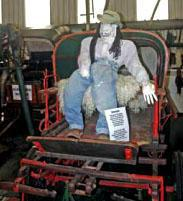 Old carts and scarecrows in the Albertnia Museum.