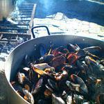 Mussels being passionately prepared at Die Strandloper, Langebaan