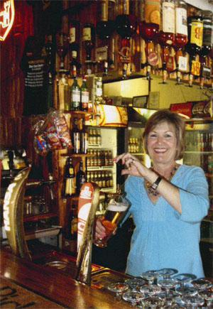 Lady Jennifer, daughter of the Duke and Duchess of Athol, in her bar.