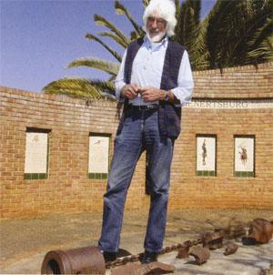 The imposing Louis Ghanguion, local historian, author and researcher at the Long Tom monument that he erected with the help of his family. At his feet are the remnants of a blown-up Long Tom canon that was used by the Boere in the Anglo Boer War.