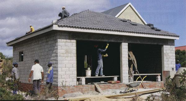 It can take four workers using the Stumbelbloc just three days to build small dwellings or garages,includin roof, from foundation level