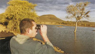Zede Smit, the manager of Motswiri Lodge, birdwatching at Tlou Dam