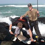 Fishing on the rocks at Mazeppa Bay, Wild Coast, Eastern Cape
