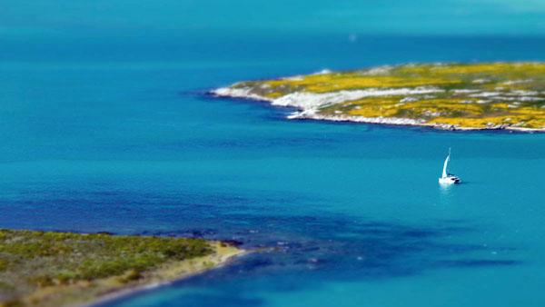 The water of Langebaan Lagoon is glassy, a still aquamarine stretch among the rose-coloured salt marshes and the dark splotches of fynbos.