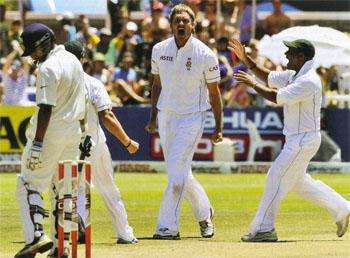 Marching orders: Paul Harris celebrates the wicket of Gautam Gambhir at Newlands in 2011. Harris was Cricket South Africa's Newcomer of the Year in 2007 after returning from Pakistan with 12 wickets and an average of 20.66 for the series.