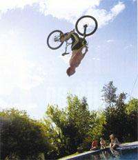 Daytime practice for the midnight pool jumping event. Surely no-one was going to try it on the pink BMX
