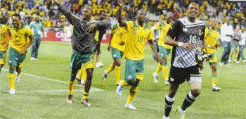 Embarrassing Bafana players, led by goalkeeper Ithumeleng Khune, celebrate making it into the 2012 AFCON - only to discover later that they had not qualified.