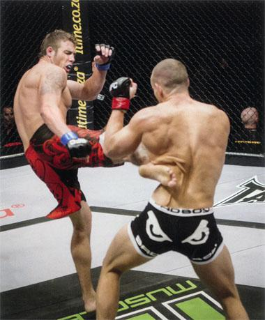 Side swipe Armand de Bruyn [left]softens up Abrie Valentine for the kill. Abrie was the first of Mike Mouneimne's fighters to succumb to an arm bar submission.