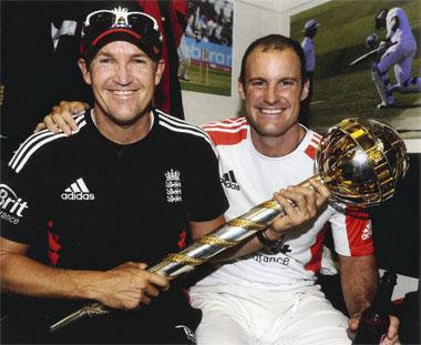 Top dogs: Andy Flower and Andrew Strauss celebrate a series victory against India - and their ascension to the world No 1 position - at the Oval in August 2011. They are pictured holding the phallic monstrosity that is the Test Championshp Mace.