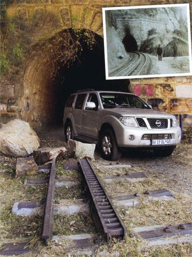 The Pathfinder in front bf the NZASM tunnel, near Waterval-Boven in Mpumalanija. Some say that Paul Kruger's train stopped inside the tunnel while his commando buried a treasure inside' the tunner. However, professional excavations and treasure hunts have failed to produce anything. Note the old railway tracks and sleepers. These are all that remain of the original track (insert, right).