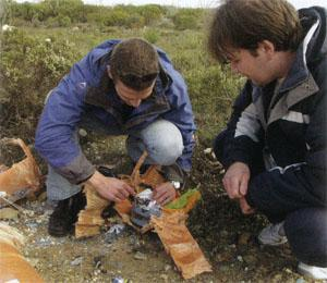Both teams check to see if there's anything to salvage after the rocket ploughed into the ground with their projects still onboard.