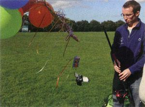 To test its viability, they used 50 helium-filled party balloons (attached to a fishing rod) to get it airborne before releasing it over one of UCT's sports fields.