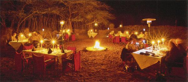Diners are served under the stars in a boma.