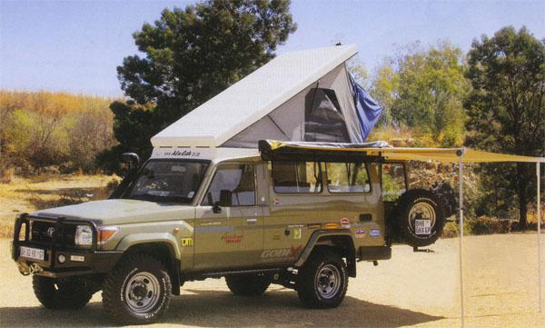 Andrew White's Land Cruiser may look like a standard model, but it's not. Its roof has been chopped off and replaced with a roof-top tent. This allows direct access to the tent from the cabin.