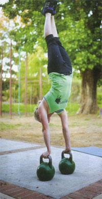 Anneke de Beer does a kettlebell handstands