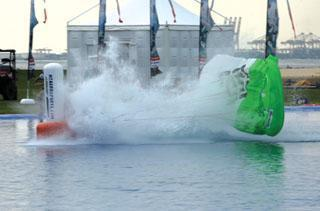 Canopy pilot hits the water during one of his swoops