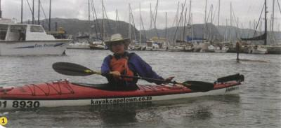 Paddler's Kayak Shop's resident instructor Derek Goldman demonstrates how best to perform the basic paddle strokes in the calm waters of Simon's Town's harbour. 1) How to hold the paddle and twist your waist.