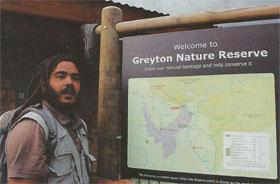 Marshall Rinquest at the Greyton Nature Reserve signpost at the entrance of the reserve, on the northern side of Park Street.