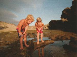Alex (4) and James (6) explore the multitude of rock pools at Corner Rocks near the mouth of the Bushmans River.