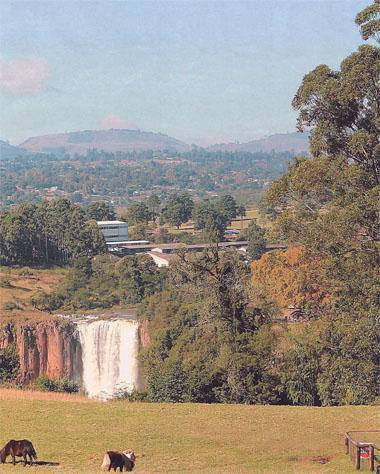 In the distance Howick Falls also known as KwaNogqaza  - Place of the Tall One