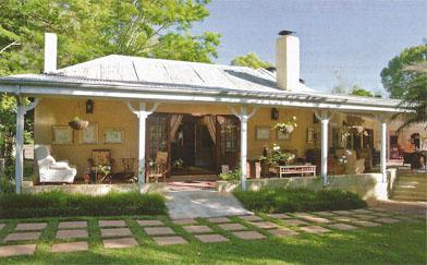 While away afternoons with tea and a book on Jatinga Country Lodge's gracious veranda.