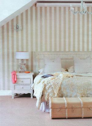 Striped wallpaper from St Leger & Viney and a crystal chandelier give Casey's bedroom a romantic and feminine feel.