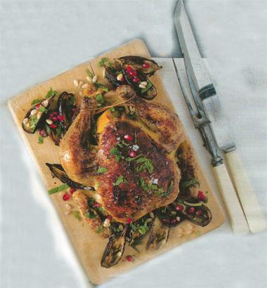 Fragrant roast chicken with baby aubergines and pine nuts