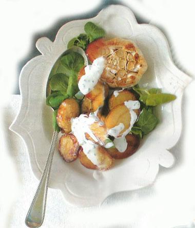Crispy potato salad with roast garlic sour cream dressing