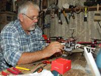 The team resident film maker Glen Thomas in his workshop