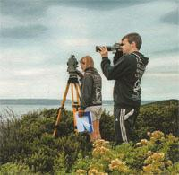 A researcher and intern study the comings and goings of dolphins and whales around the Mossel Bay area.