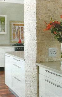 Debbie incorporated the structural column into the central island and clad it in natural stone.