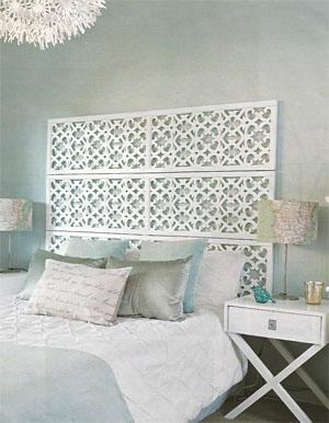 Instead of a headboard, a room divider adds detail and texture