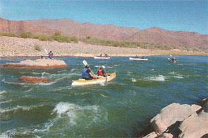 Paddling the Orange River, the border between Namibia and South Africa, in the heat of the day.