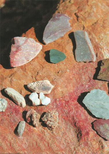 Examples of Middle Stone Age implements, fossil bone and shell, as well as ochre, at the mouth of Cave 13C. The material derives from cave 13B, some 13 metres above