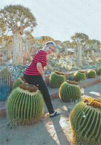 Maxi Compion poses with the spiny chairs planted at a homestead on the R359