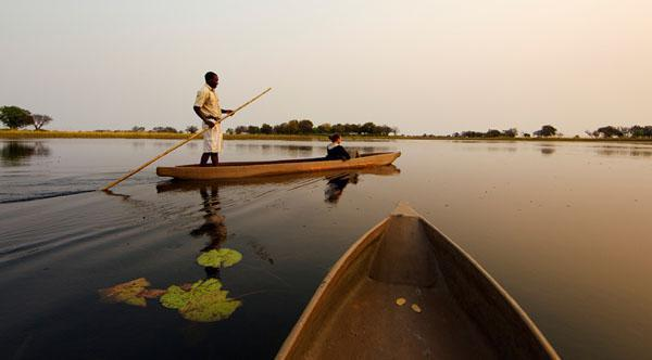 A mekoro ride on Botswanas Okavango Delta is one of the best ways to explore its wildlife