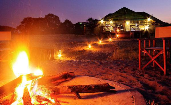 A typical night on safari at Camp Savuti in Botswana involves a roaring fire which sets the scene for a true African experience